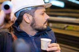 Vending Machine Worker Inspiration Worker Drinking Coffee From Vending Machine Stock Photo Image Of