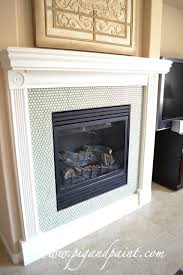 Colored penny tile makes a beautiful tile surround for a fireplace | From  Pig and Paint