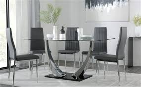 peake glass and chrome dining table black gloss base with 6 leon grey chairs