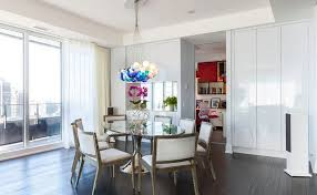 globe chandeliers above the glass dining table