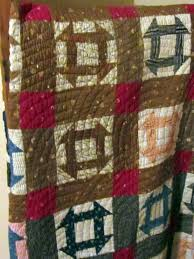 antique hole in the barn door quilt with baptist fan quilting