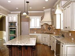 elegant white kitchen cabinets with granite countertops and recessed lighting ideas photos of black dark marble best for backsplash pictures in kitchens