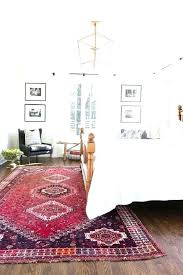 rug under bed white bedroom with red area rugs in
