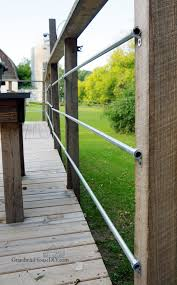 diy inexpensive how to deck rails out of steel conduit to look like steel wire deck