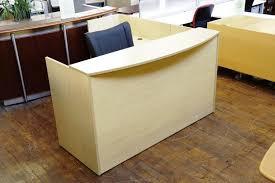 image of wood l shaped reception desk