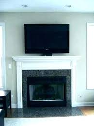 mounting tv over fireplace above fireplace hiding wires wall mount over fireplace mounted above ideas mounting