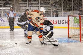 ryan hamilton battles the rain outdoors at memorial stadium during the condorstown outdoor clic on january 7 2018 he became just the second player in
