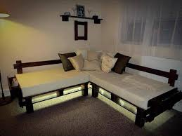 pallet sofa with lights and white cushion