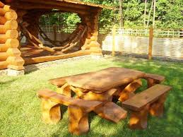 furniture made from trees. gazebo and table with chairs made of logs furniture from trees n