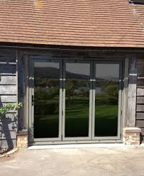 A set of trifold doors incorporated in a barn conversion
