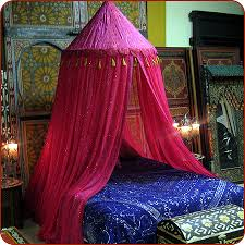 Beautiful Moroccan Bedroom with canopy bed