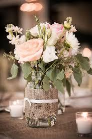 Mason jar flower arrangements in blush pink.