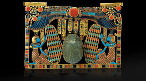 winged large scarab riding on a sacred barque and flanked by the desses isis