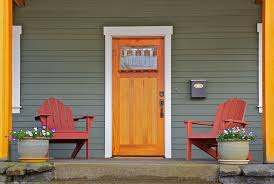 mission style stained wood front door with beveled glass surrounded by two adirondack chairs and flowers door replacement