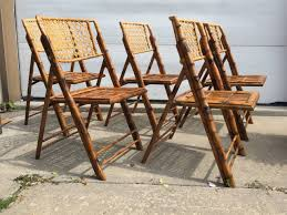 set of five scorched bamboo frame folding chairs with rattan seat folding wicker rocking chairs stratford