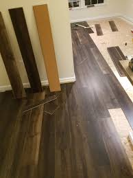 you can see above how the flooring has the cork backing which acts as the underlayment we used a miter saw to cut any abstract pieces around the corners