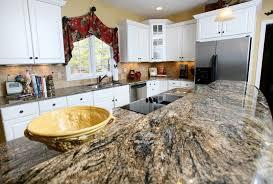 brown black kitchen granite countertops white cabinets