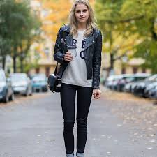 biker jacket black jeans graphic sweatshirt