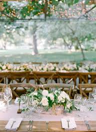 garden wedding centerpiece idea with blush table runner greenery and white fl centerpiece samantha kirk photography