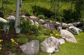 Rock gardens are perfect for lining paths and walkways. Large rocks work to  keep people