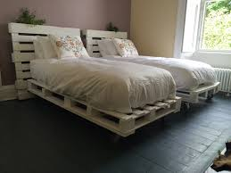 Single bed frames made out of pallets.