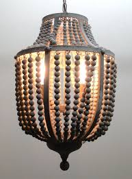 gray aged iron and wooden bead chandelier hanging light fixture the kings bay