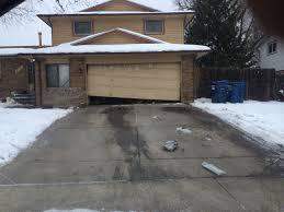broken garage doorGarage Door Repair Service Serving Aurora  All Of Colorado