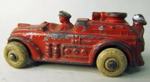 slush mold fire truck cast lead white rubber tires driver figure and figure on back american made 1930 s approx 2 75 long very good 40 00