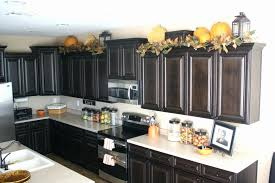 decorations on top of kitchen cabinets. Kitchen Decorating Ideas Above Cabinets Lovely Top Idea How To Decorate For Decorations On Of