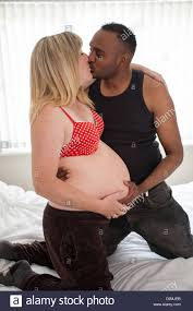 Black man kissing white woman
