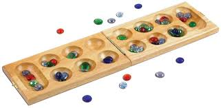 Game With Stones And Wooden Board Mancala is the classic game that's played with 100 colorful glass 5