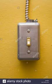 Light Switch Wall Mount An Exposed Light Switch Fixture Mounted On A Yellow Painted