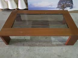 lovely modern glass and wood coffee table
