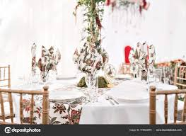 served round banquet table outdoor in marquee decorated flowers and silk catering concept photo by malkovkosta
