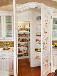 Inspiration for a mediterranean kitchen pantry remodel in Phoenix with  raised-panel cabinets, white