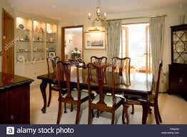 traditional dark oak furniture. Dining Room Traditional Dark Wood Furniture. - Stock Image Oak Furniture H