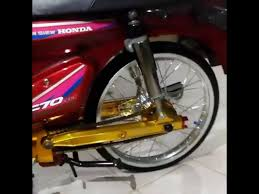 candy red honda c70 you