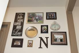 to hang a wall collage