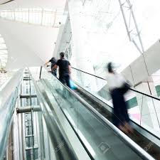 people on escalator. people rush on escalator motion blurred. shopping abstract. stock photo - 16506759