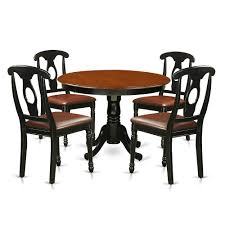 5 Pc Set With A Round Kitchen Table And 4 Leather Dinette Chairs In