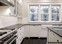 Black Granite Countertops With Tile Backsplash