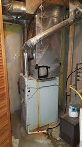 carrier 96 furnace. before- old carrier furnace with ac coil leaking water. 96