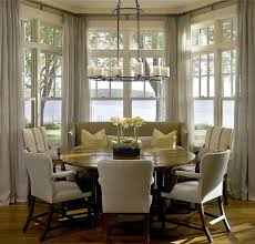 dining area lake view bay window monochromatic color scheme round table hickman