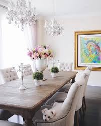 dining room decor 2 double chandeliers light fixtures restoration hardware dining table and chairs statement art statement fl arrangement