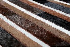 hair on hide detail of black brown and white patchwork cowhide rug in stripes