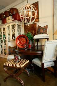 showroom tour los gatos the cathedral mahogany round dining table has a octagonal carved urn base the upholstered side