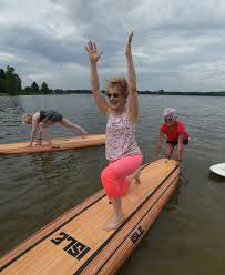 Troy woman, 67, leads unique fitness classes on paddleboards at Stony Creek  | Life | voicenews.com