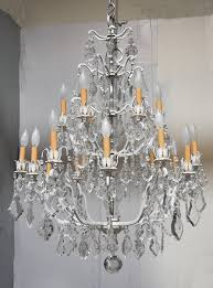 a stunning 18 light crystal chandelier on a white painted metal frame uniquely updated to