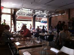 Glass garage doors restaurant Privacy Glass Bar With Garage Doors Share Oneskor Living In Clinton West 55th Street Calumet Cafe Pinterest