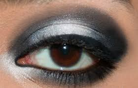 step 6 line your eyes with black liquid eyeliner black and white eye makeup
